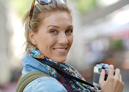 Woman outside with camera