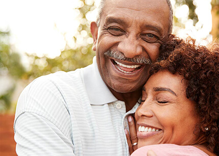 Older African-american couple hugging